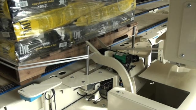 7004 Example Overhead wrapper Clipping incl top platen - SYMACH Palletizers